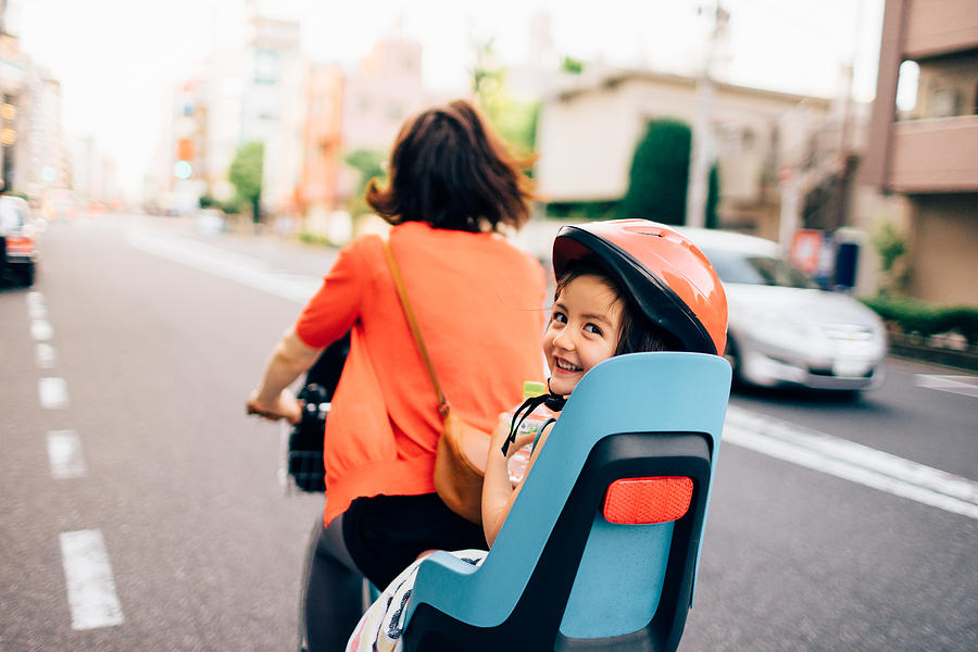 Cycling with a toddler girl in urban city, Tokyo Photograph by Ippei Naoi