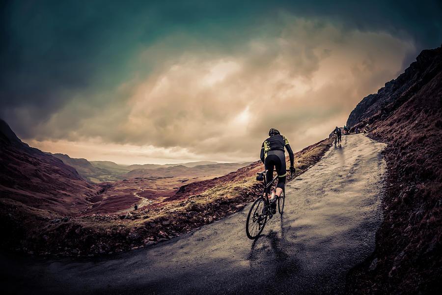 Cyclist On Hardknott Ramp Photograph by Steve Fleming