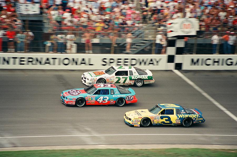 Dale Earnhardt Richard Petty and Rusty Wallace Race at Michigan by Retro Images Archive