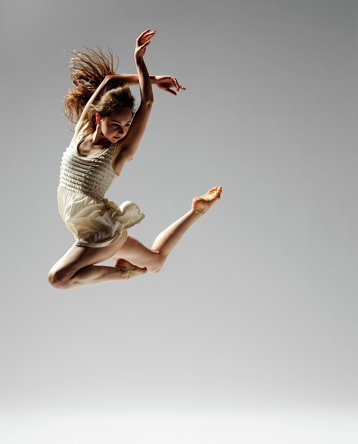 Dance White Dress Jump Photograph by Copyright Christopher Peddecord 2009