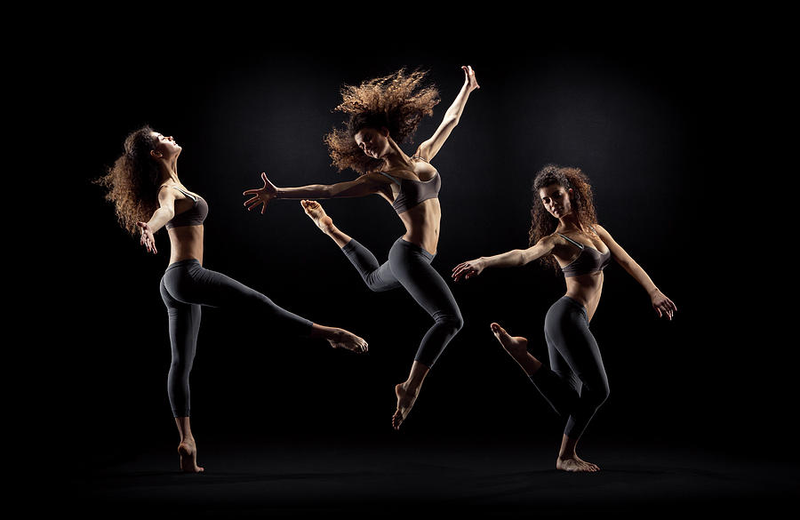 Dancer Pose On Black Background Photograph by Zonecreative