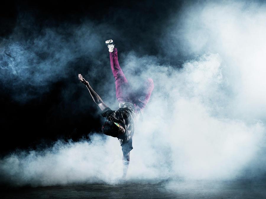 Dancer Surrounded By Smoke Photograph by Henrik Sorensen