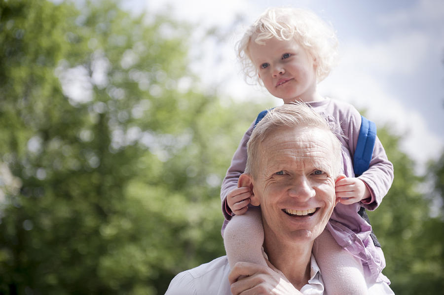 Daughter On Fathers Shoulders, Holding His Ears Photograph by Lucy Lambriex