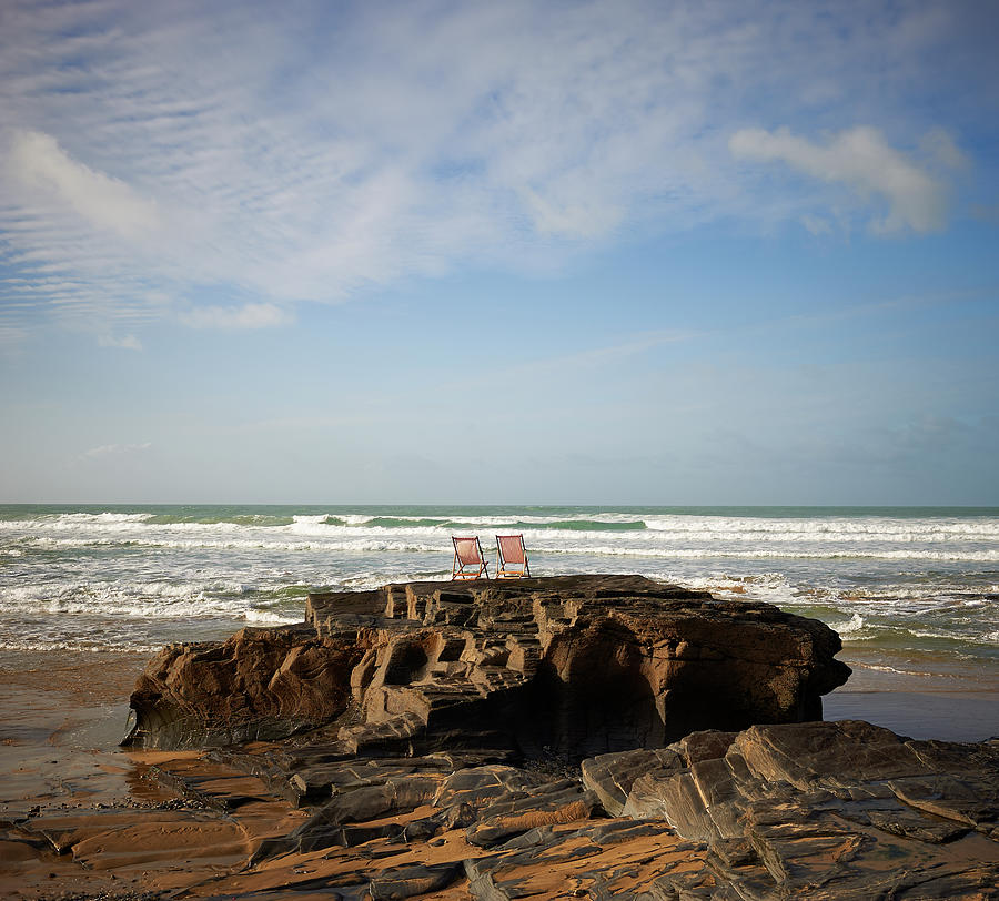 Deck Chairs On Coastal Rock Looking Out Photograph by Dougal Waters