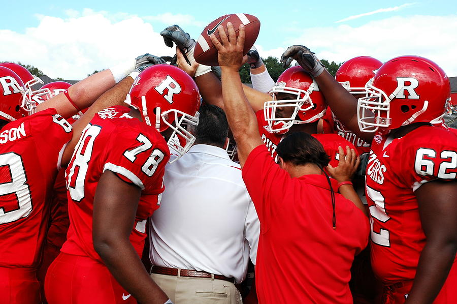 Rutgers Photograph - Defensive Huddle by Allen Beatty