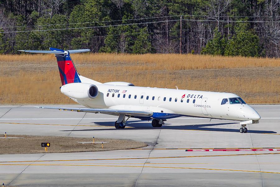 Delta Airlines ERJ-145LR Photograph by Richard Jack-James