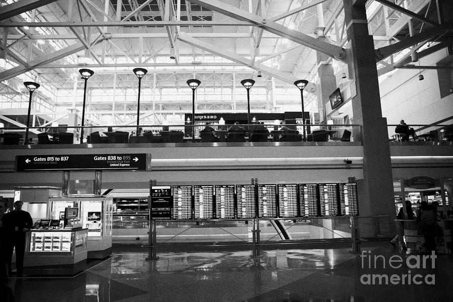 Departures Photograph - departures board at concourse b Denver International Airport Colorado USA by Joe Fox