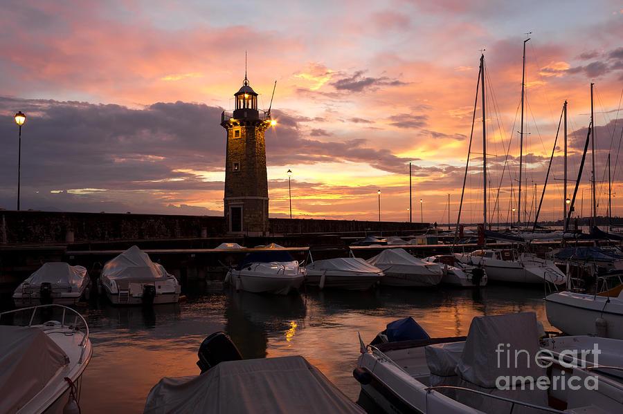 Sun Photograph - Desenzano Del Garda Marina Old Lighthouse Sunrise by Kiril Stanchev