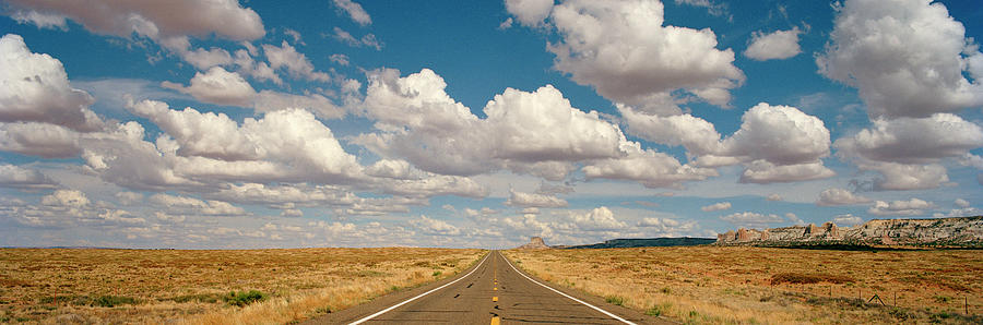 Desert Road With Cloud Formations Above Photograph by Gary Yeowell