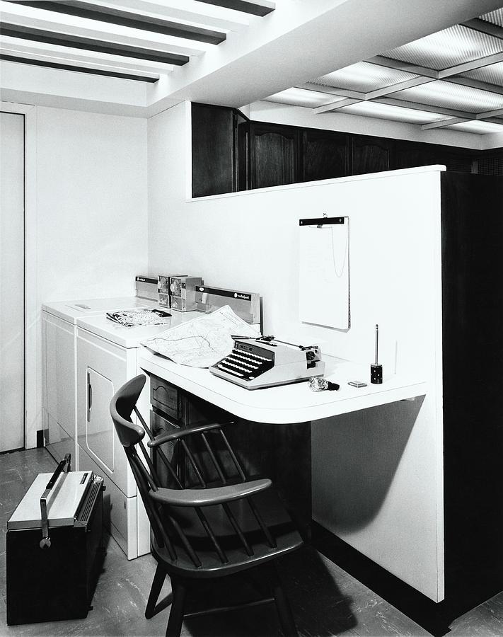 Desk Next To Laundry Photograph by Pedro E. Guerrero