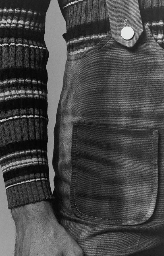 Detail Of A Sweater And Overalls Photograph by Peter Levy