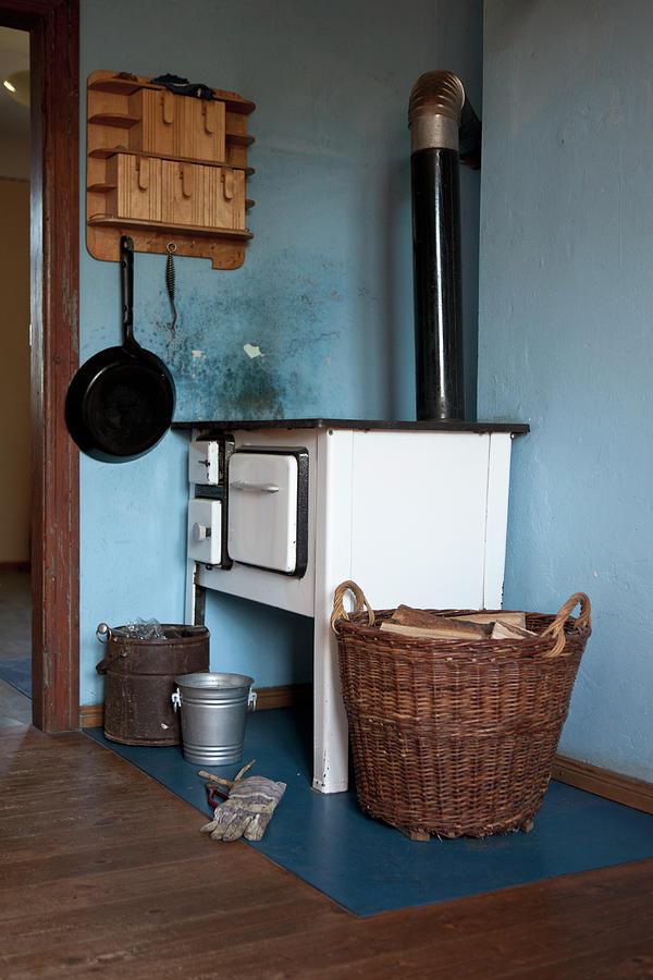 Hanging Photograph - Detail Of An Old-fashioned Kitchen by Halfdark