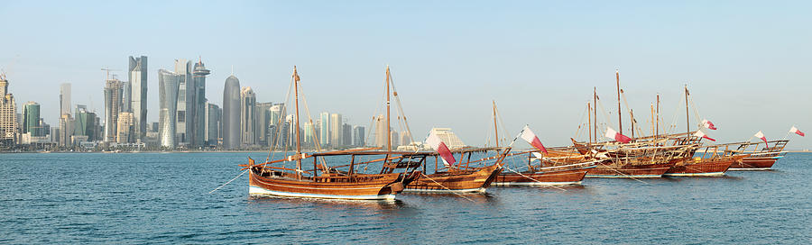 Dhow Photograph - Dhows On Parade In Doha by Paul Cowan