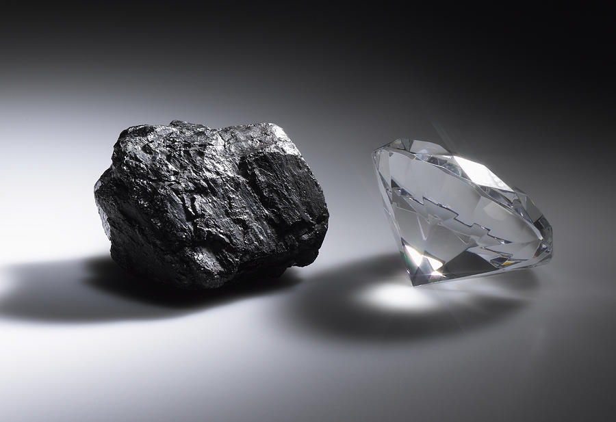 Diamond and piece of coal Photograph by Jeffrey Hamilton