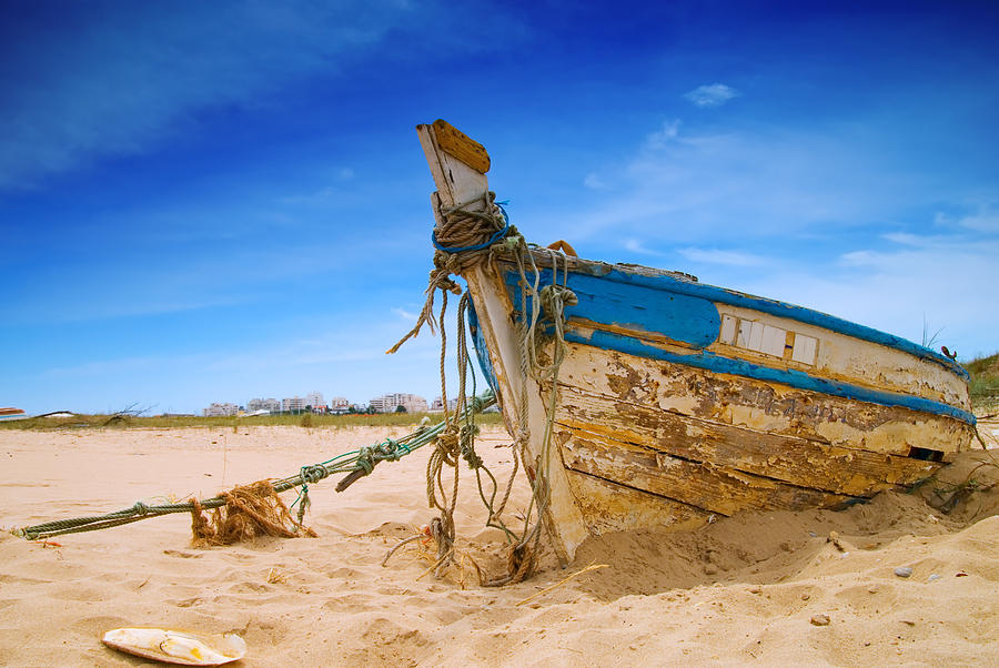 Fishing Boat Photograph - Dilapidated Boat At Ferragudo Beach Algarve Portugal by Amanda Elwell