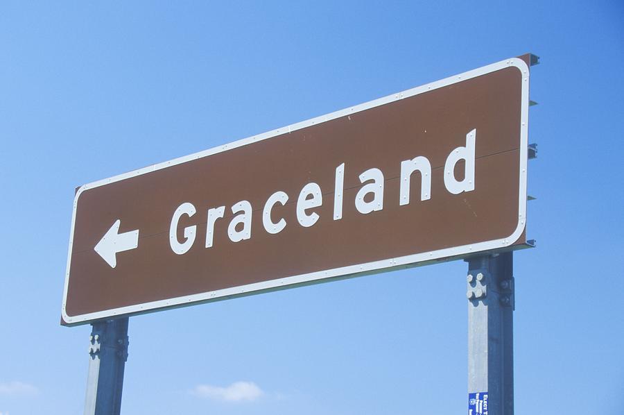 Directional sign to Graceland, home of Elvis Presley, Memphis, TN Photograph by VisionsofAmerica/Joe Sohm
