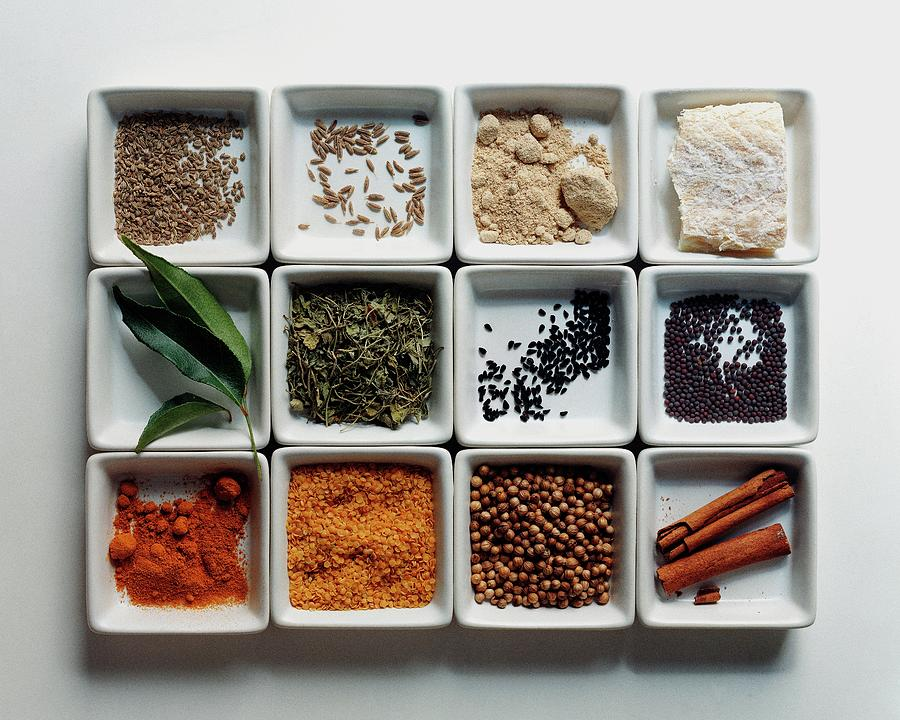 Dishes Of Spices Photograph by Romulo Yanes