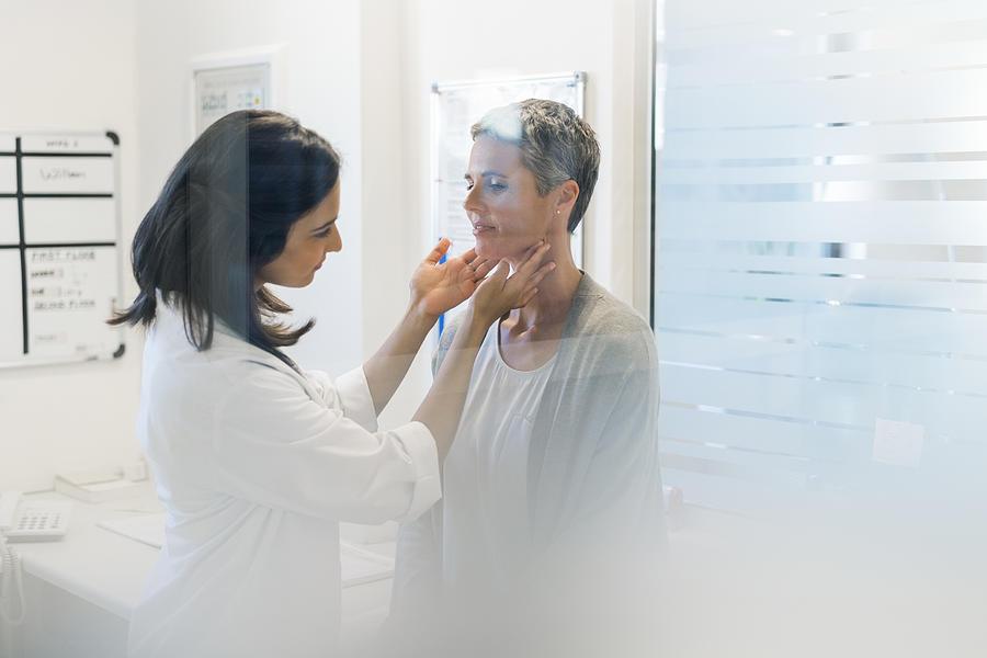 Doctor examining female patient fat hospital Photograph by Stígur Már Karlsson /Heimsmyndir