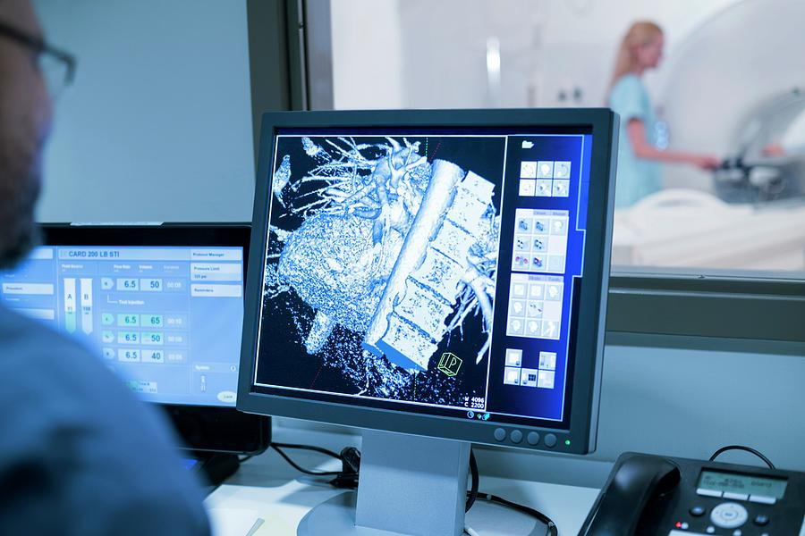 Indoors Photograph - Doctor Looking At Mri Scans On Monitor by Science Photo Library