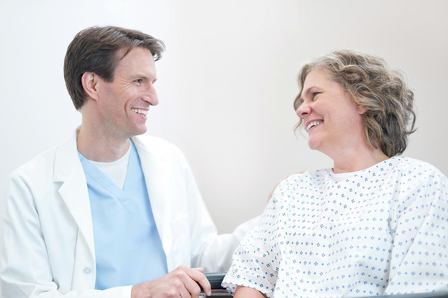 Adult Photograph - Doctor Smiling At Woman Patient by Science Photo Library