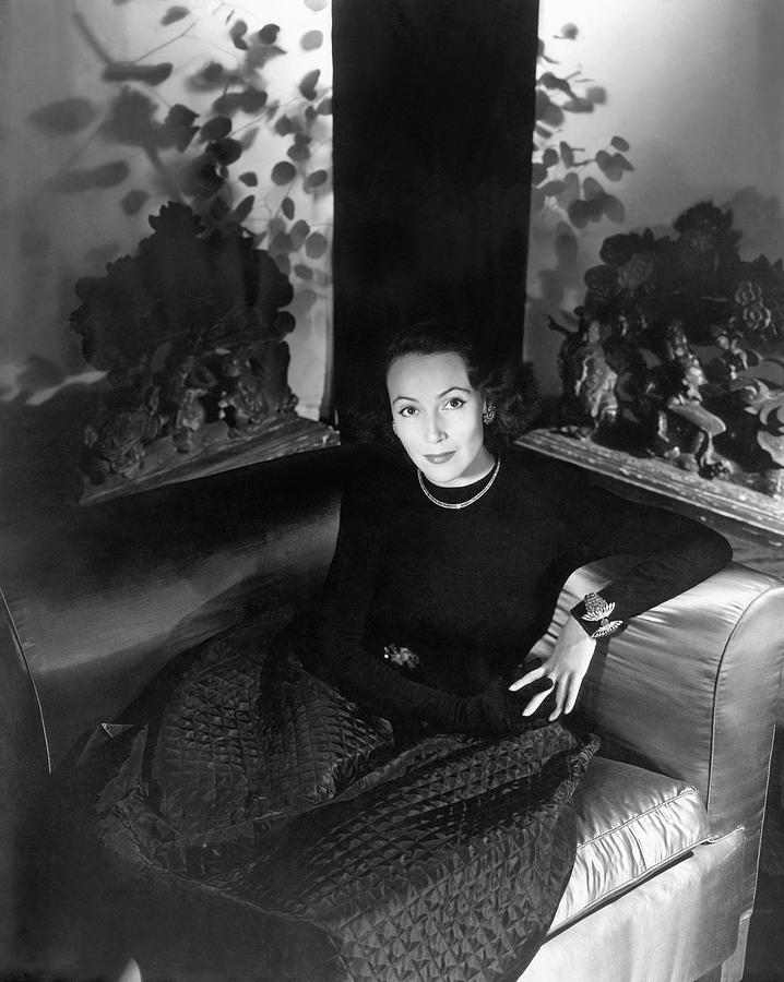 Dolores Del Rio Sitting In An Armchair Photograph by Horst P. Horst