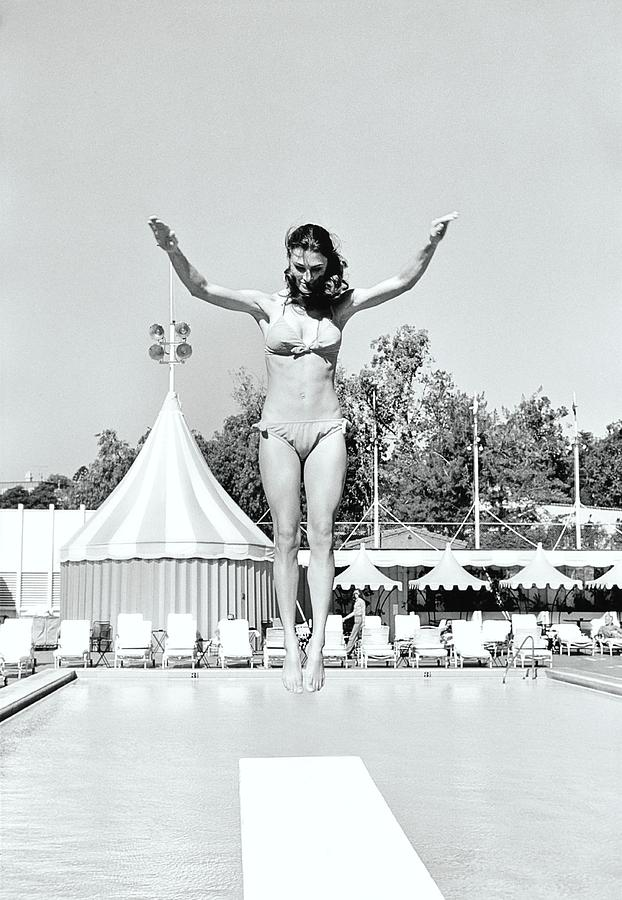 Donna Garrett Jumping On Diving Board Photograph by William Connors