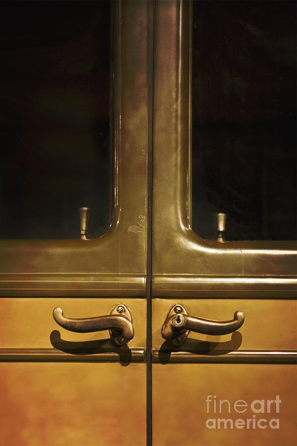 Door Handles Photograph by Margie Hurwich