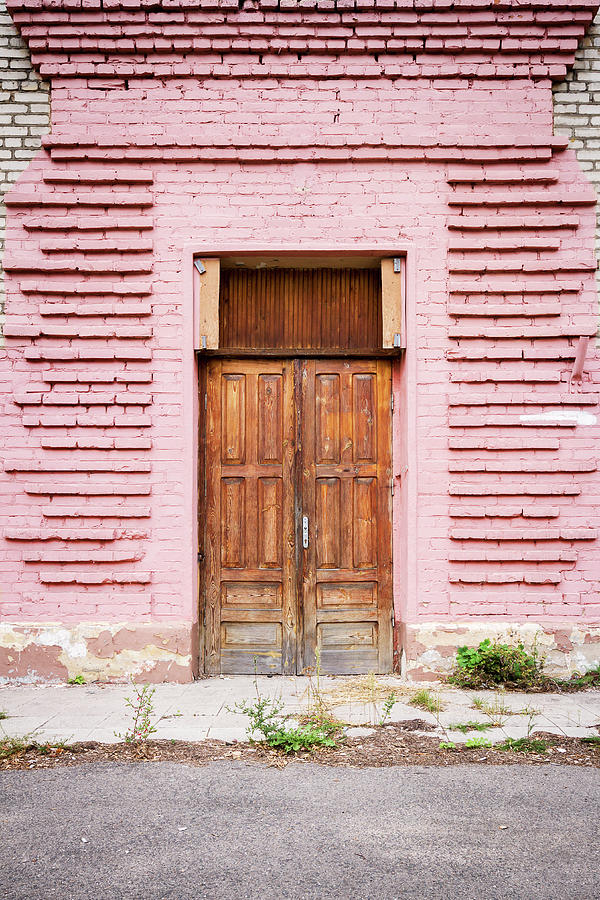 Door In A Pink Wall Photograph by Wylius