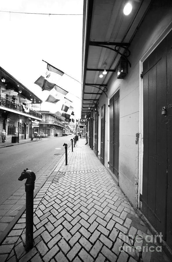 Pictures Photograph - Down Bourbon Street by John Rizzuto