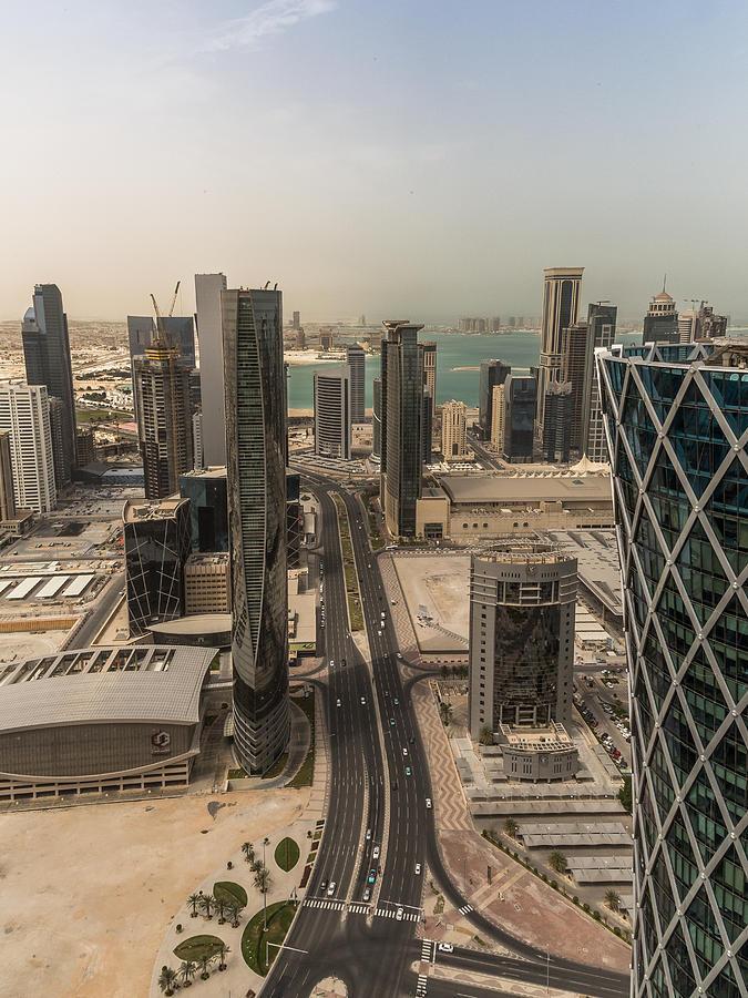 Skyline Photograph - Down On Doha by Charlie Tash