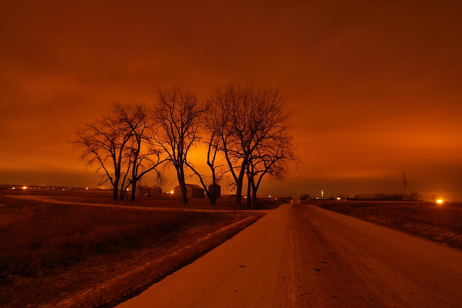 Roads Photograph - Down The Haunting Road Under The Orange Sky by Jeff Swan