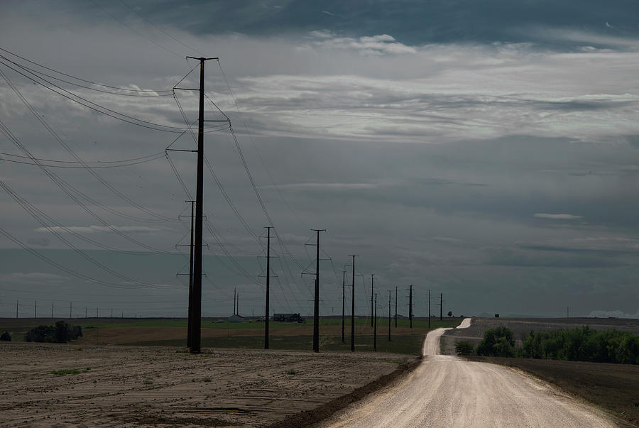 Dramatic Dirt Road And Power Lines Photograph by Ed Freeman