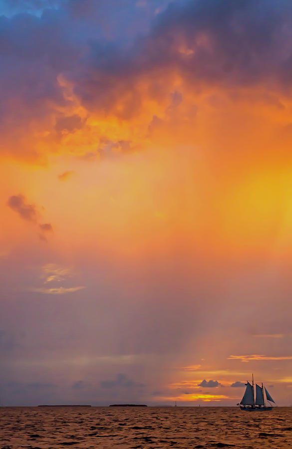 Dramatic Sunset with sailing ship off the isle of Key West Florida by Photographic Arts And Design Studio