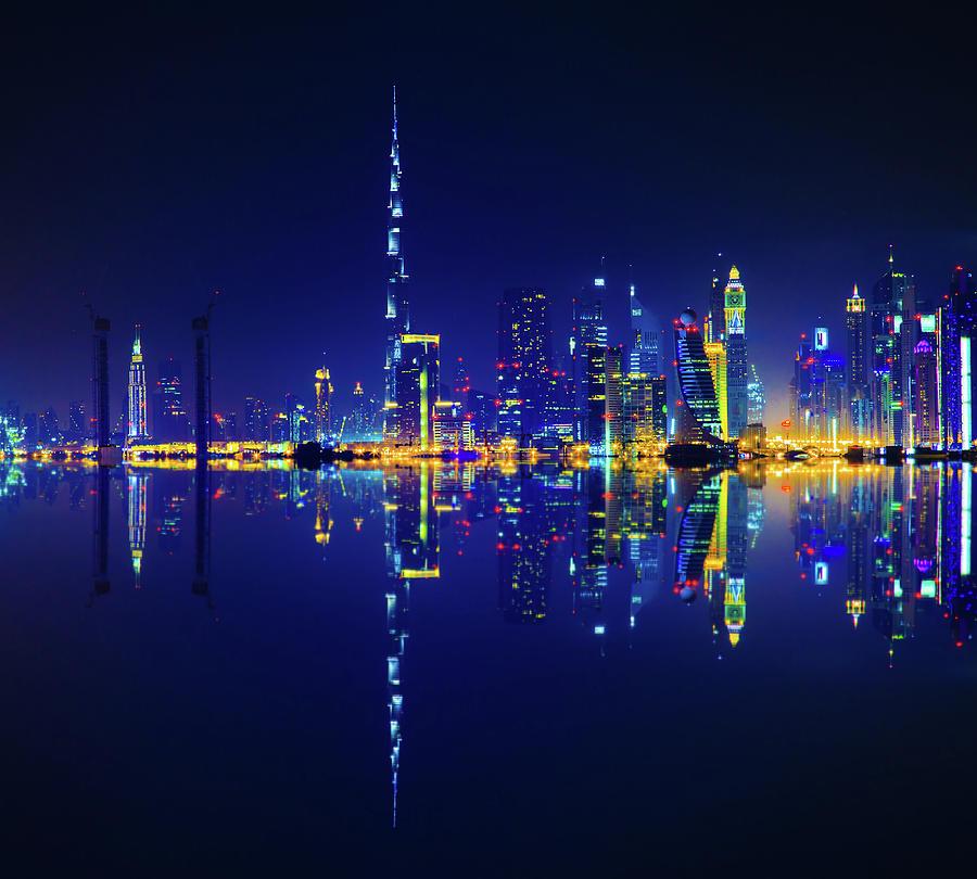 Dubai Skyline Reflection At Night Photograph by Serts