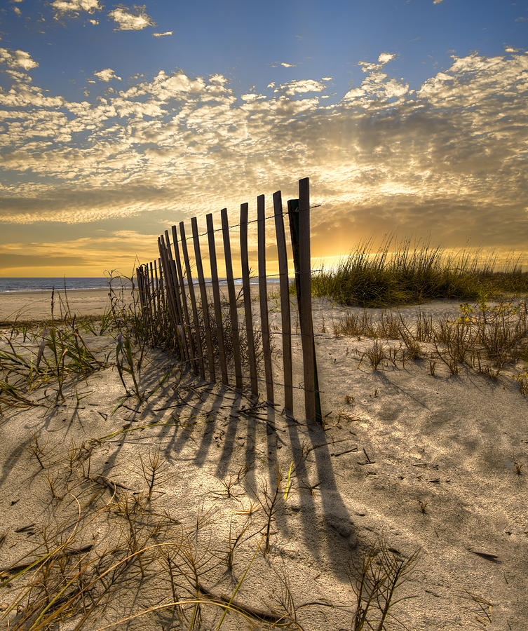 Clouds Photograph - Dune Fence At Sunrise by Debra and Dave Vanderlaan