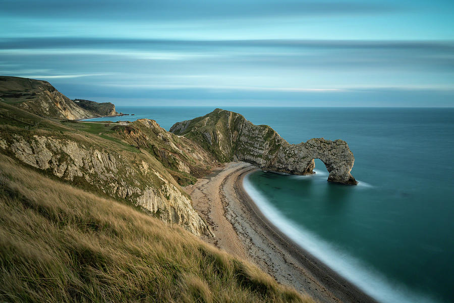 Durdle Door At Sunset Photograph by Fotosearch
