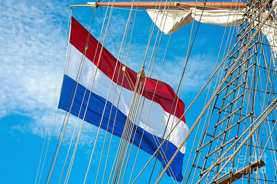 Symbol Photograph - Dutch flag on Tall Ship. by Jan Brons