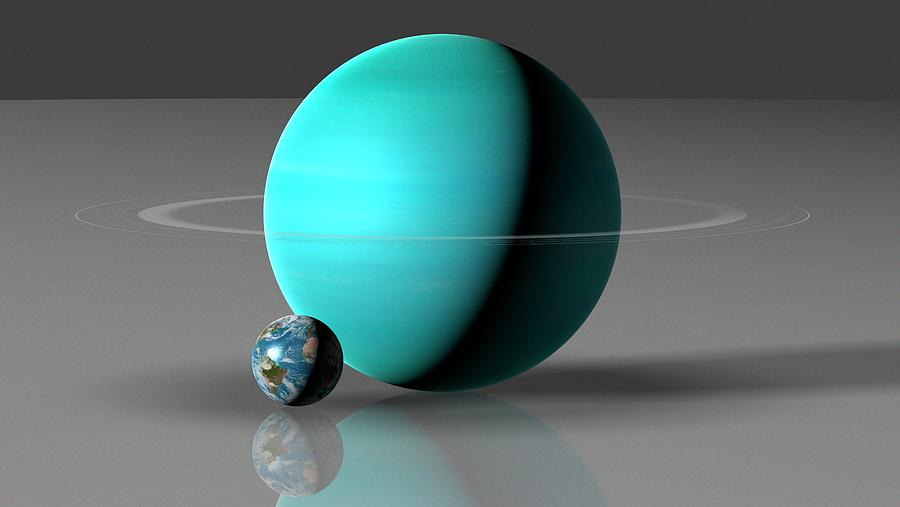 Astronomy Photograph - Earth Compared To Uranus by Mark Garlick/science Photo Library