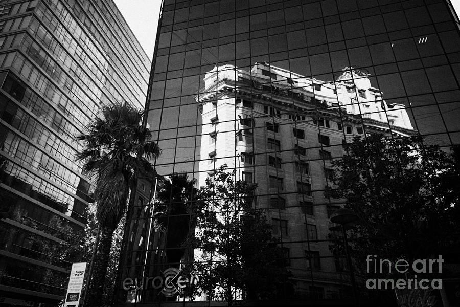 Building Photograph - edificio ariztia building reflected in modern bank buildings in the financial district of Santiago Chile by Joe Fox