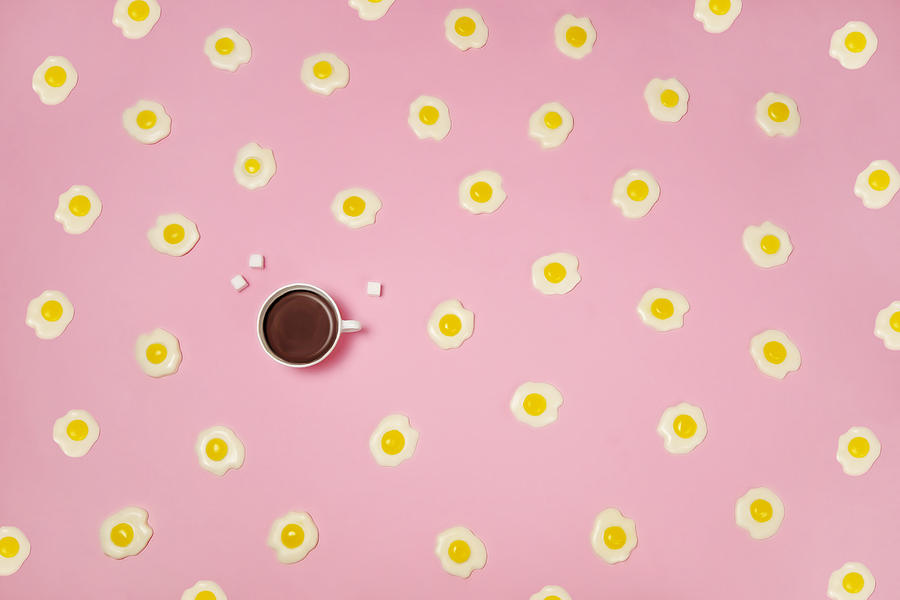 Breakfast Photograph - Eggs With Coffee Cup On Pink Background by Juj Winn