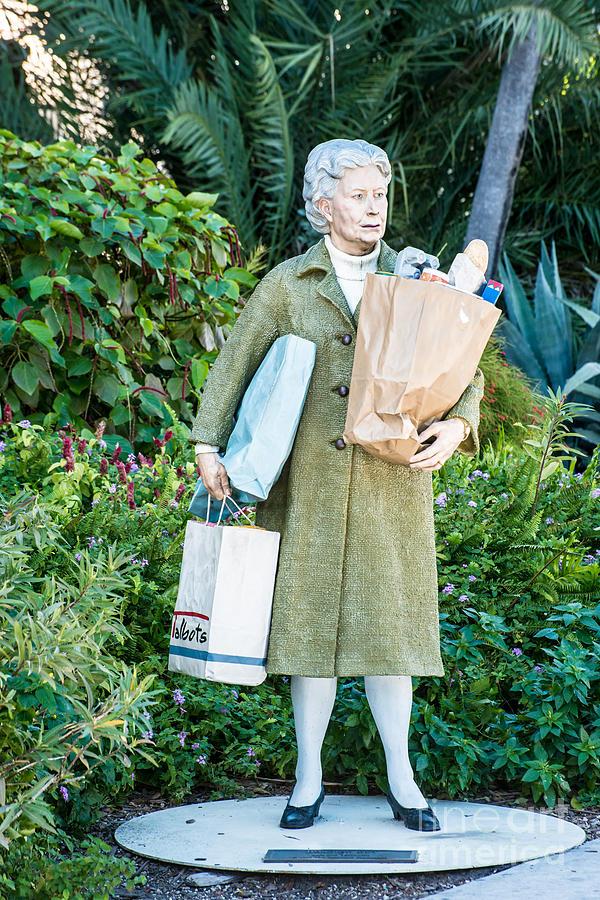 America Photograph - Elderly Shopper Statue Key West by Ian Monk