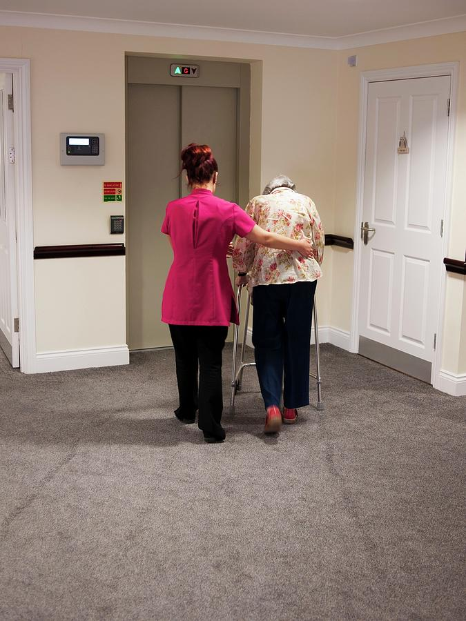 Adult Photograph - Elderly Woman With Carer by John Cole