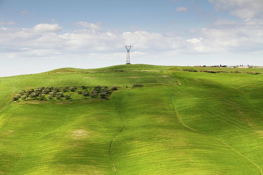 Electric Pylon On Sloping Wheat Fields Photograph by Christiana Stawski
