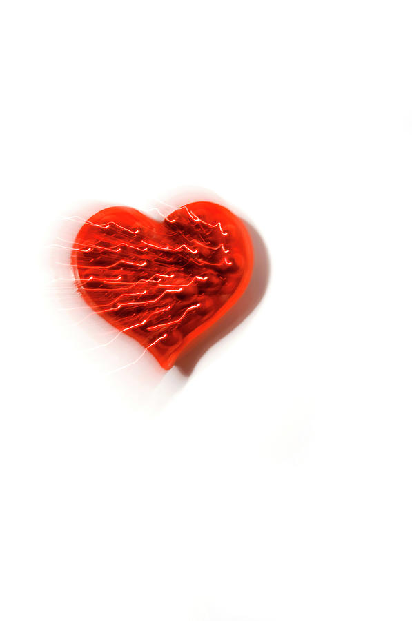 Electric Red Heart On A White Background Photograph by Daryl Solomon