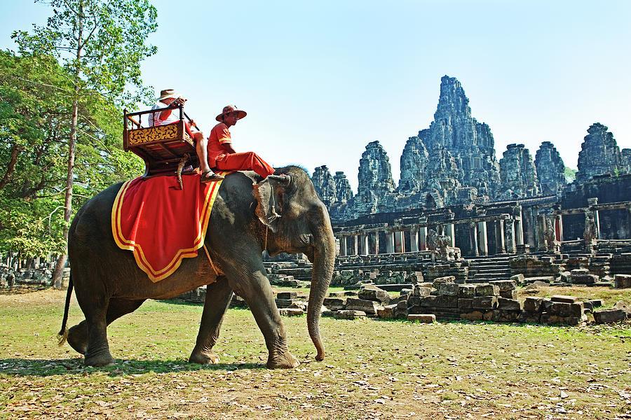 Elephant Ride At The Bayon, Angkor Wat Photograph by John W Banagan