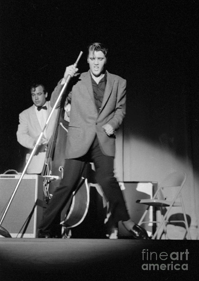 Elvis Presley Photograph - Elvis Presley And Bill Black Performing In 1956 by The Harrington Collection