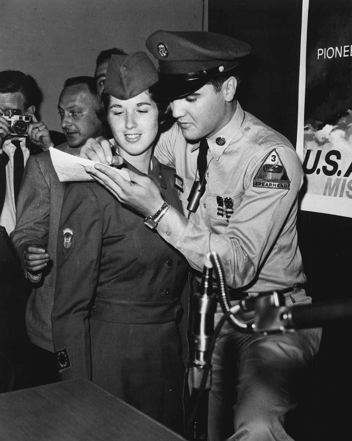 Classic Photograph - Elvis Presley Signs Autograph For Girl by Retro Images Archive