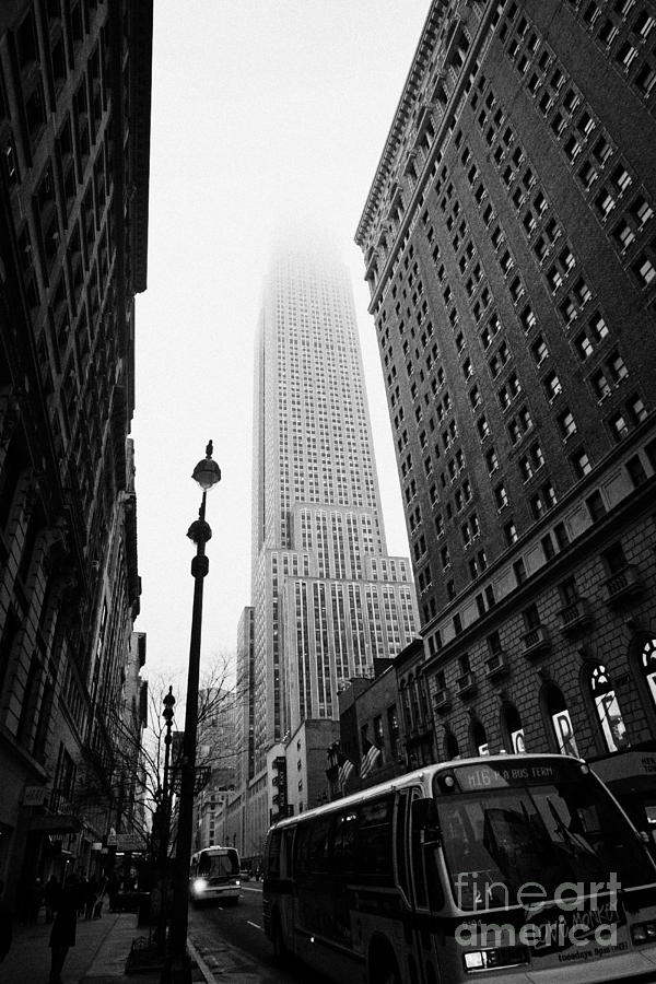 Usa Photograph - Empire State Building Shrouded In Mist And Nyc Bus Taken From 34th And Broadway Nyc New York City by Joe Fox