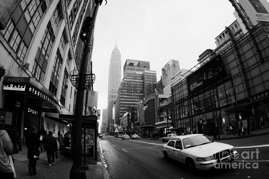 Usa Photograph - Empire State Building Shrouded In Mist As Yellow Cab Taxi New York City by Joe Fox
