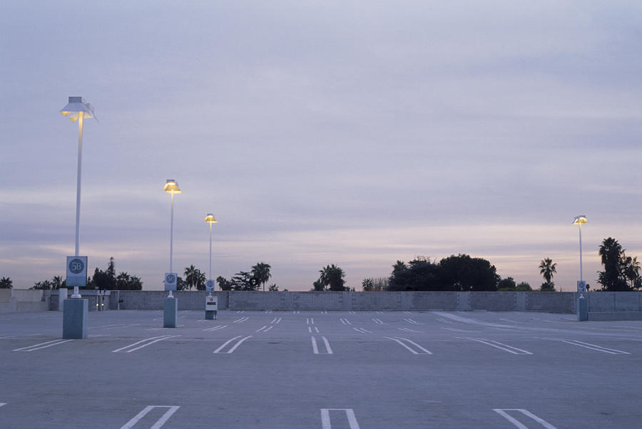 Empty Parking Lot at Dusk Photograph by Pete Starman